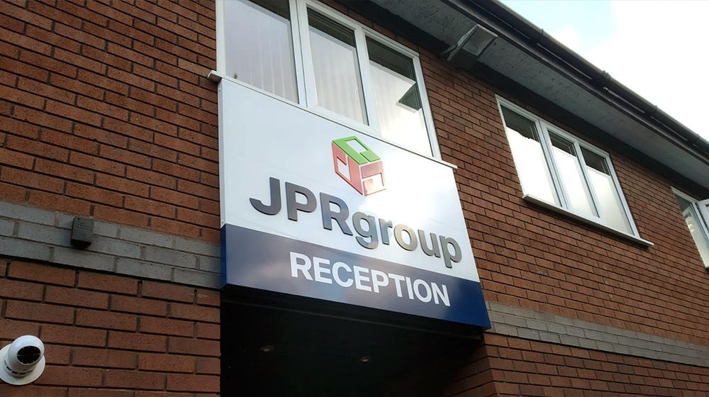 JPR Group rebrand - reception sign on building